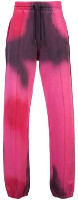 Off-White spray paint track pants