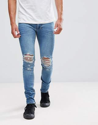 Religion Jeans In Skinny Fit With Rips And Zip
