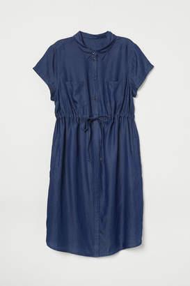 7b1dbbefb6a H M MAMA Lyocell Denim Dress - Blue