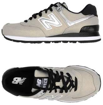 574 SYNTHETIC SHINY LEATHER - FOOTWEAR - Low-tops & sneakers New Balance OyAxew