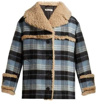 Miu Miu Plaid wool-blend and shearling coat