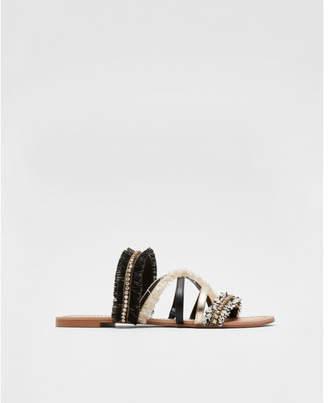Express fringe sandals