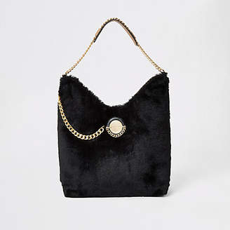 River Island Black faux fur coin front slouch bag
