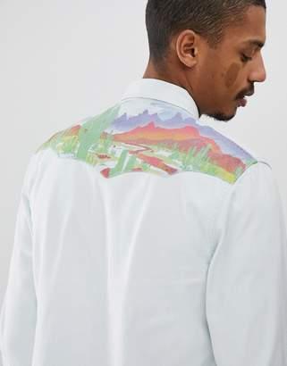 Wrangler western back shoulder print denim shirt in bleached indigo
