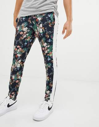 Asos DESIGN skinny joggers in retro track fabric with floral print and side stripes