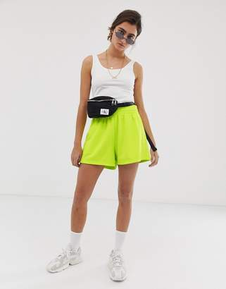 Weekday jersey shorts in neon yellow