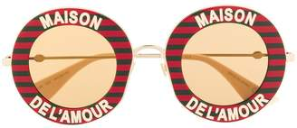 Gucci round frame striped sunglasses