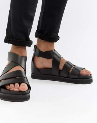 48e7638e1 Asos Design DESIGN gladiator sandals in black leather with chunky sole