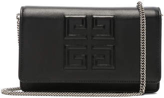 Givenchy Emblem Chain Wallet in Black | FWRD