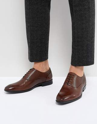 Asos DESIGN Oxford Shoes In Brown Leather With Emboss Panel