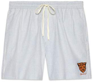 Gucci Oxford stripe shorts with tiger