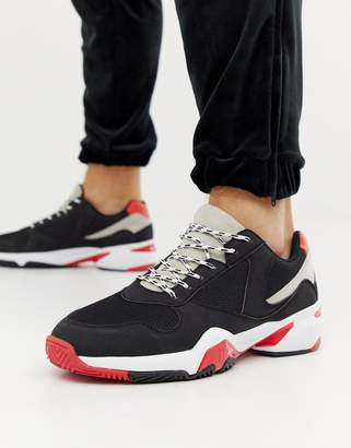 Asos Design DESIGN sneakers in black and red with chunky sole