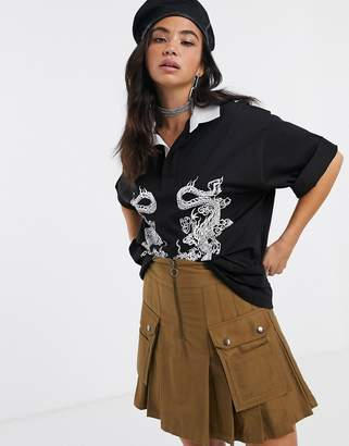Dragon Optical New Girl Order oversized polo top with contrast collar & print
