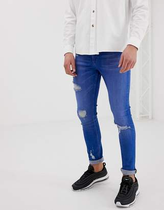 Asos Design DESIGN super skinny jeans in bright blue wash with rips