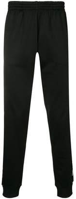 Moschino logo embellished track pants