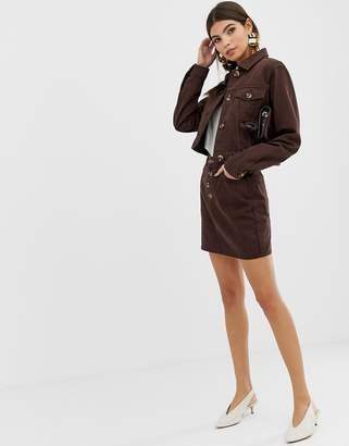 Asos Design DESIGN denim mini skirt with mock horn buttons in chocolate