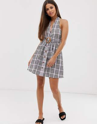 d8d6cbd0c36 Asos Design DESIGN halter neck mini button through linen sundress with  buckle in check