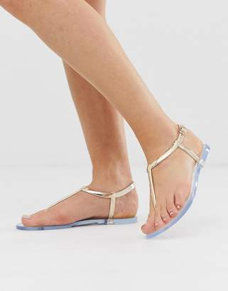 South Beach rose gold jelly toe post flat sandals