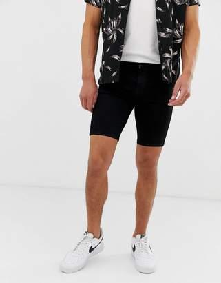 Asos Design DESIGN spray on denim shorts with power stretch in black