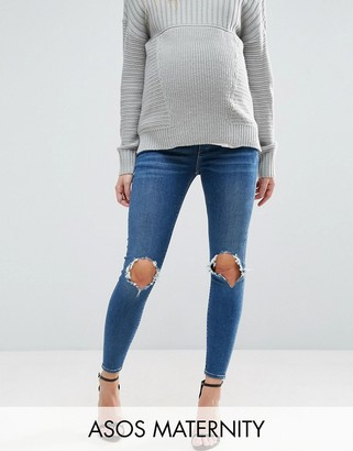 ASOS Maternity ASOS MATERNITY RIDLEY Skinny Jeans in Roy Dark Stonewash with Busted Knees With Under the Bump Waistband $48 thestylecure.com