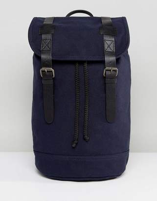 Asos Design DESIGN backpack in organic cotton in navy with real leather trims