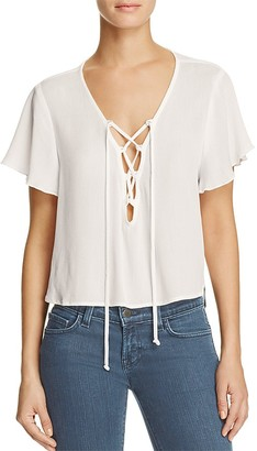 Show Me Your MuMu Oasis Lace-Up Crop Top $96 thestylecure.com