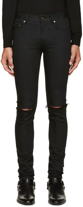 Saint Laurent Black Original Low Waisted Ripped Skinny Jeans $750 thestylecure.com