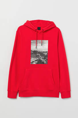 H&M Hooded top with a motif - Red