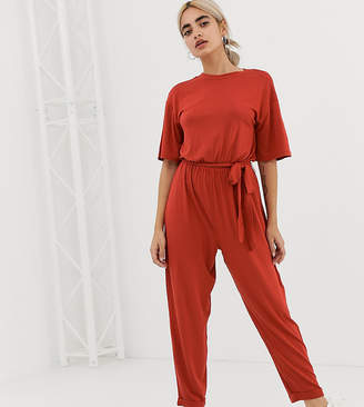 a3e88b84c8 Asos DESIGN Petite t-shirt jumpsuit with tie waist