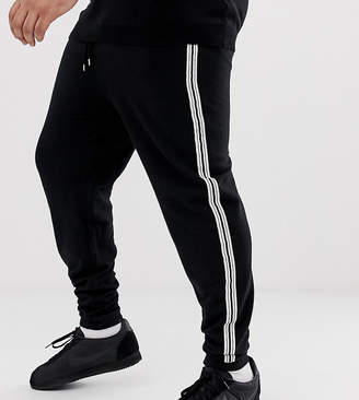 0776331c Asos Design DESIGN Plus skinny joggers with side stripe taping in black