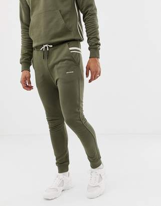 Religion skinny fit joggers with taping