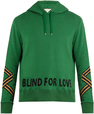 GUCCI Stripe-detail cotton-jersey hooded sweatshirt $1,290 thestylecure.com