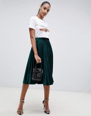 Missguided pleated velvet midi skirt in green