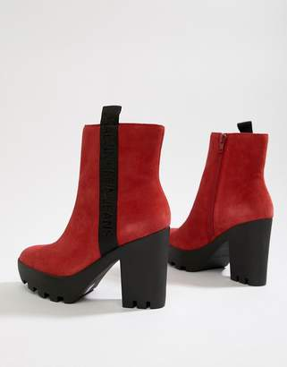 Calvin Klein chunky red suede branded heeled ankle boots