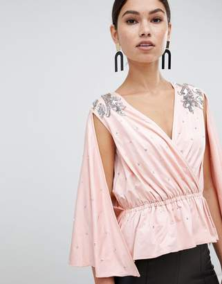 Asos DESIGN wrap peplum kimono sleeve top with all over embellishment