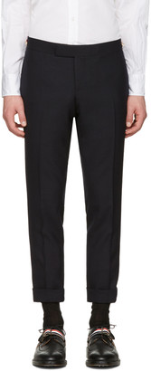 Thom Browne Navy Low-Rise Skinny Side Tab Trousers $1,010 thestylecure.com