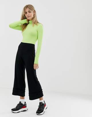 Asos Design DESIGN cropped wide leg trousers with ruffle hem