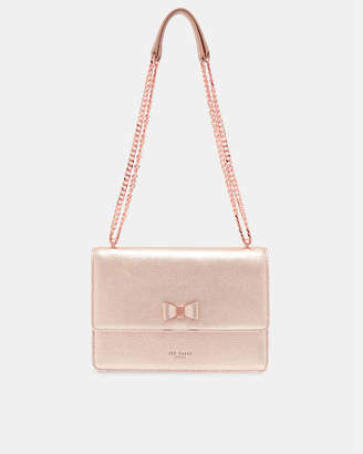 3cc5b96ce0f47b ... at Ted Baker · Ted Baker DORLEA Bow detail metallic leather cross body  bag get new ...