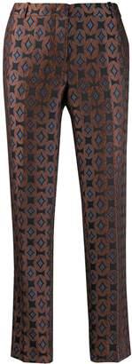 Kiltie geometric-print cropped trousers
