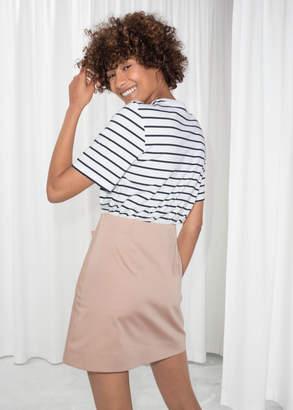 Asymmetric Button Mini Skirt