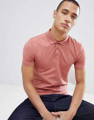 Asos DESIGN muscle fit polo in jersey in pink