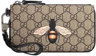 3cac06598e8a Gucci Bee print GG Supreme pouch