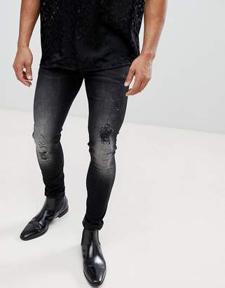 Asos DESIGN Extreme Super Skinny Jeans In Vintage Washed Black With Rips