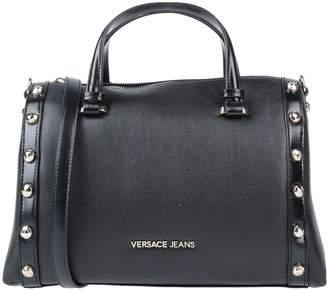 e06a8395cc20 Versace Black Faux Leather Handbags - ShopStyle