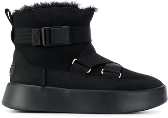 UGG crossover strap buckled boots