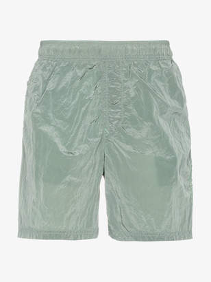 Stone Island green metal garment dyed swim shorts