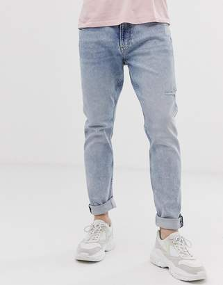 dc271339d Tommy Jeans modern tapered 1988 jeans in light wash