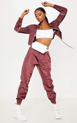 PrettyLittleThing Burgundy Contrast Stitch Shell Joggers