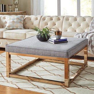 Weston Home Libby Smooth Top Cushion Ottoman Coffee Table with Champagne Gold Straight Base, Multiple Colors