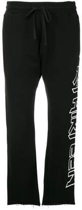 R 13 raw hem track pants